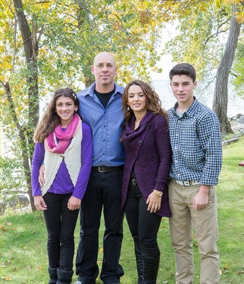 Family picture in front of trees - Tony & Diane - Parent Profile - Adoption O.N.E - Private Adoption Agency in Ontario